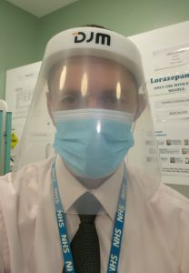 Portrait photo of Ian Grace wearing PPE